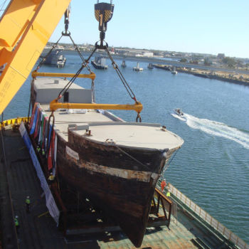 SS City of Adelaide loaded onto Barge